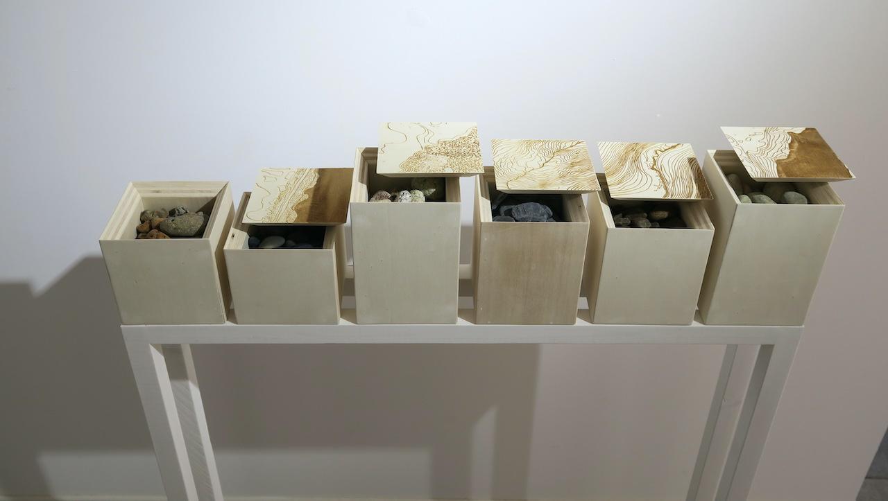 """Raphaël Galley, """"Cairn"""" (2021), bois, cailloux. Série de 6 boîtes  - 500 € pièce ou 2 700 € les 6."""